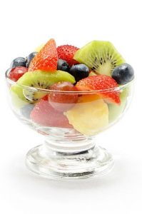 Cup of fresh fruits or fruit salad isolated on white. More pictures...